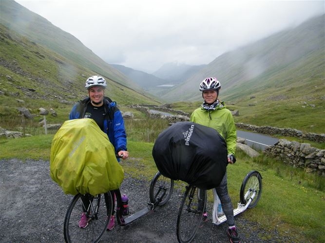 At the peak of the saddle Kirkstone Pass in the English national park The Lake District, together with her friend Petra.
