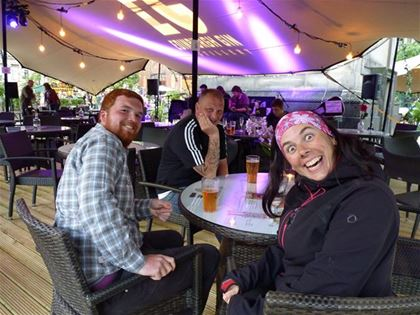 Having beer with her rescuers Alan and Andy, who advised her how to find accommodation in Edinburgh, which was overcrowded due to the ongoing music festival.