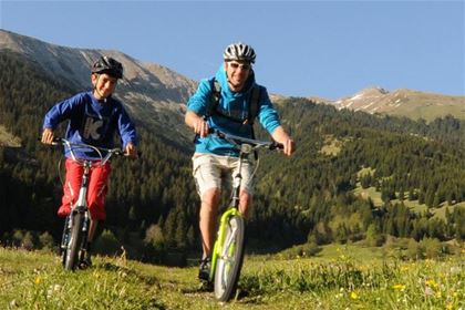 Make mountain cycling more exciting with an adrenalin downhill ride.