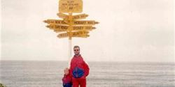 With his daughter at New Zealand's southernmost point – the town of Bluff.