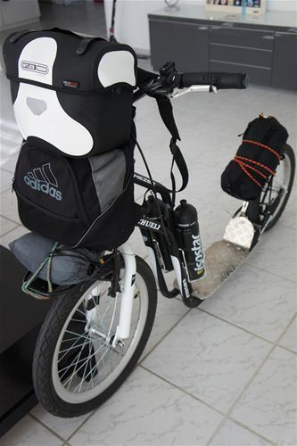 Specially adapted scooter is ready for the departure.